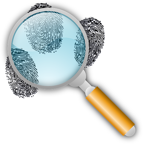 Fingerprints, magnifying glass